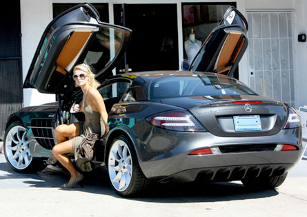 Paris Hilton out of car