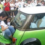 No sweat for 21 who crammed into a Mini Cooper
