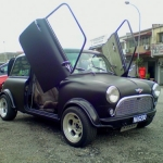 Matte black Mini Cooper with scissor doors