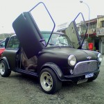 <b>Matte black Mini Cooper with scissor doors</b>